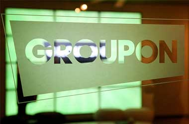 Groupon swings to Q3 profit, raises FY17 profit view